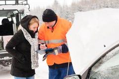 Woman fill document broken car snow mechanic Royalty Free Stock Photos