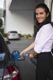 Woman fill up car Royalty Free Stock Photography