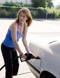 Woman filling auto gas tank_3 Royalty Free Stock Photos