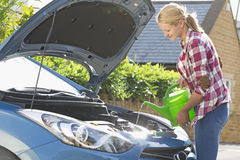 Woman Filling Car Radiator With Water Royalty Free Stock Photo