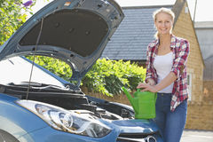 Woman Filling Car Radiator With Water Royalty Free Stock Photography