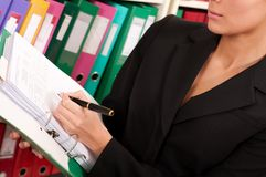 Woman filling files in the  folders Stock Photo