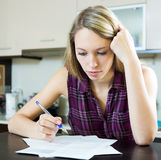 Woman filling in financial documents Royalty Free Stock Photos