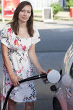 Woman filling gasoline inside the car Royalty Free Stock Photography