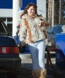 Woman filling her car stock photos