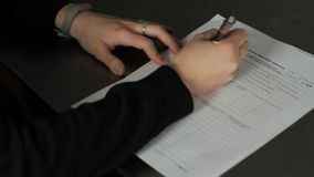 Health Insurance Marketplace tax form. Woman filling out a Health Insurance tax form in 1080p stock video footage