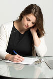 Woman filling out a job application. Royalty Free Stock Image
