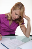 Woman filling in paperwork Stock Photos