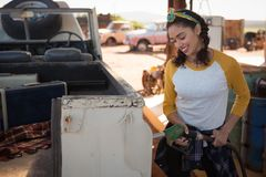 Woman filling petrol in car at petrol pump. On a sunny day Stock Images