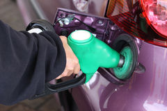 Woman Filling Petrol Tank Stock Photo