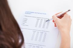 Woman filling survey form Royalty Free Stock Photo