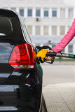 Woman filling up car at petrol station Royalty Free Stock Photography