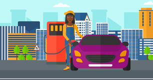 Woman filling up fuel into car. An african-american woman filling up fuel into the car on a city background vector flat design illustration. Horizontal layout Royalty Free Stock Image