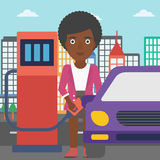 Woman filling up fuel into car. An african-american woman filling up fuel into the car on a city background vector flat design illustration. Square layout Royalty Free Stock Image