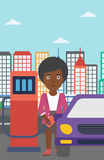 Woman filling up fuel into car. An african-american woman filling up fuel into the car on a city background vector flat design illustration. Vertical layout Stock Images