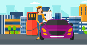 Woman filling up fuel into car. A woman filling up fuel into the car on a city background vector flat design illustration. Horizontal layout Royalty Free Stock Photos