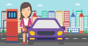 Woman filling up fuel into car. A woman filling up fuel into the car on a city background vector flat design illustration. Horizontal layout Royalty Free Stock Images