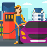 Woman filling up fuel into car. A woman filling up fuel into the car on a city background vector flat design illustration. Square layout Stock Photo