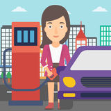 Woman filling up fuel into car. A woman filling up fuel into the car on a city background vector flat design illustration. Square layout Royalty Free Stock Photography