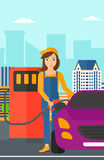 Woman filling up fuel into car. A woman filling up fuel into the car on a city background vector flat design illustration. Vertical layout Stock Photos
