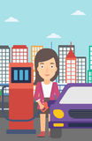 Woman filling up fuel into car. A woman filling up fuel into the car on a city background vector flat design illustration. Vertical layout Stock Photography