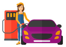 Woman filling up fuel into car. A woman filling up fuel into the car vector flat design illustration  on white background. Horizontal layout Stock Photography