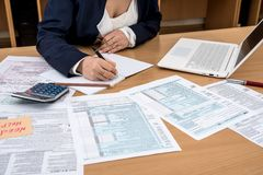 Woman filling US tax form stock images