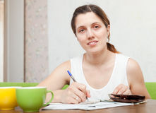 Woman fills in documents Royalty Free Stock Images