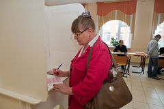 Woman fills election ballot with candidates for mayor of Moscow Stock Photo
