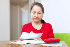 Woman fills in payment documents Royalty Free Stock Photography