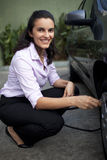 Woman fills tire Royalty Free Stock Photography