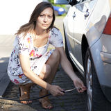 Woman fills tire Stock Photos