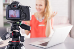 Woman filming her broadcast Stock Images