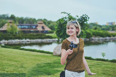 Woman filming with small personal camera Stock Photos