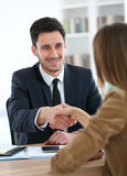 Woman and financial advisor shaking hands Royalty Free Stock Photography