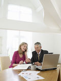 Woman With Financial Advisor At Table Stock Image