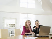 Woman With Financial Advisor At Table Royalty Free Stock Images