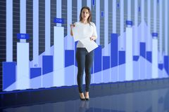 Woman and financial chart. Making presentation woman in jeans with paper sheets at blue financial chart background. 3D render Stock Images