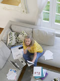 Woman With Financial Documents And Laptop stock image