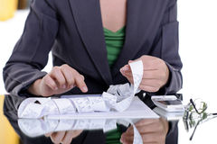 Woman financial issues. Business woman calculating bills; financial concepts Stock Photography