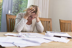 Woman in financial stress. A woman in a desperate financial situation Royalty Free Stock Photo