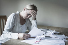 Woman in financial stress Royalty Free Stock Photography