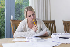 Woman in financial stress stock image