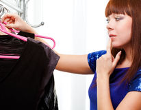 Woman finding clothes at store Royalty Free Stock Photos