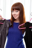Woman finding clothes at store Stock Images