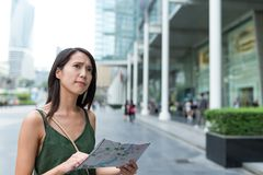 Woman finding the location on city map Stock Photography