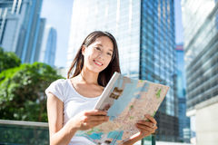 Woman finding the location on city map in Hong Kong Royalty Free Stock Image