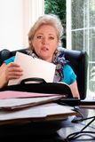 Woman finding the right papers Royalty Free Stock Photography