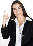 Woman Finds Solution. A young businesswoman finds the solution to a problem royalty free stock image