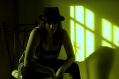 Woman. Fine woman with hat sitting in his room with a hat stock images